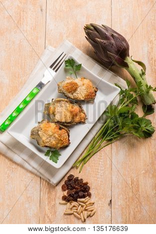 artichoke stuffed with cheese dried grape  and pine nut