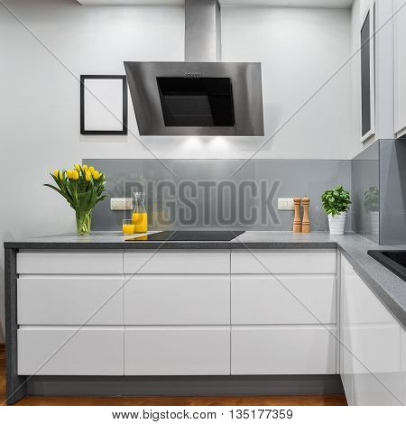 Modern kitchen with yellow tulips on countertop