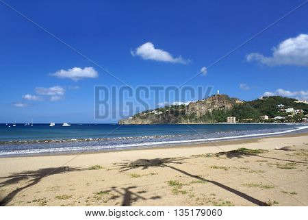 SAN JUAN DEL SUR NICARAGUA - SEPTEMBER 22 2015: Sandy beach and the shade of the palm trees in San Juan del Sur on the Pacific coast