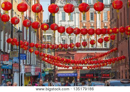 LONDON, UK - OCTOBER 4, 2016: China Town is decorated by Chinese lanterns and lots of tourists and Londoners walking on the street. ChinaTown was established in 1880 by Chinese sailors and traders