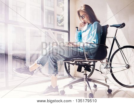 Art Director use Notebook Agency Loft Studio.Student Researching Process Work.Young Woman Working Business Startup modern Office.Analyze new creative market strategy.Blurred, film effect.Horizontal