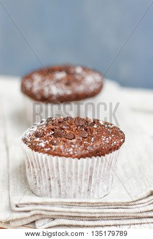 Two chocolate muffin on a fabric napkin