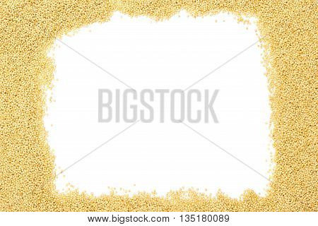 Raw uncooked amaranth seeds frame on white background with copy space