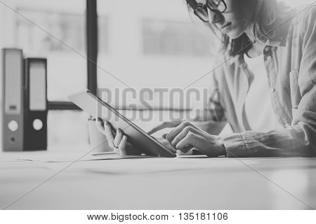 Photo Woman Using Hand Modern Digital Tablet. Touching Screen.Young Business Crew Working with New Startup Studio. Blurred, film effect. Black White