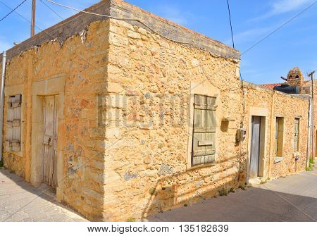 The narrow street with old houses in the historic part of Hersonissos Crete Greece.