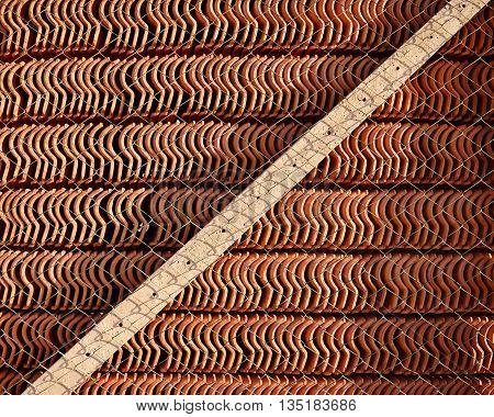 Roof Tiles in Stock Behind  a Fence