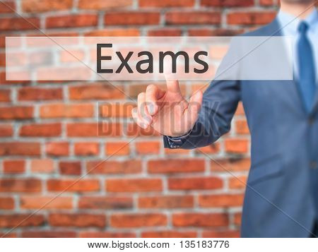 Exams - Businessman Hand Pressing Button On Touch Screen Interface.