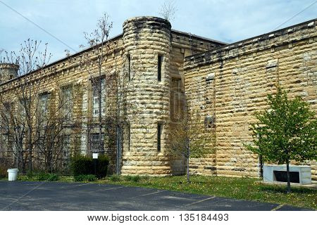JOLIET, ILLINOIS / UNITED STATES - MAY 3, 2015: A corner turret of the old Illinois State Penitentiary, which is now vacant and abandoned, in Joliet.