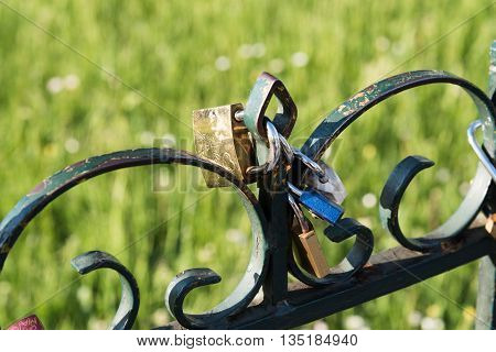 Love locks on iron rail in Paris