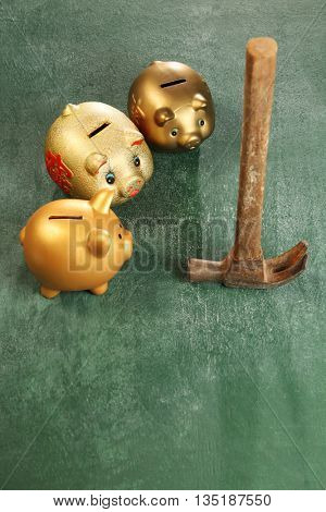 piggy bank and old hammer