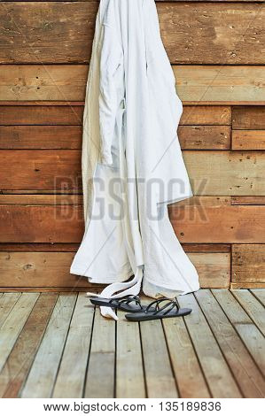 Gown Or Robe Hanging In A Spa With Sandals
