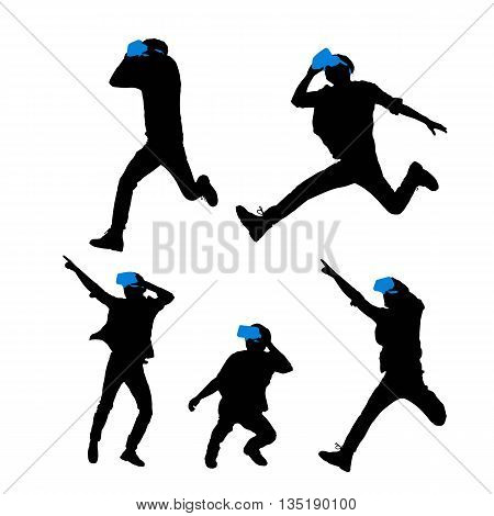 Silhouette of happy man getting experience using VR-headset glasses of virtual reality full length