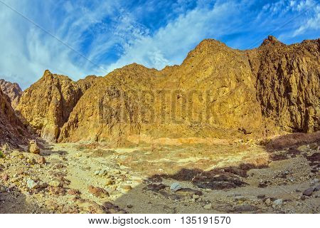 Picturesque and multi-color Black canyon in ancient Eilat mountains. Israel in January