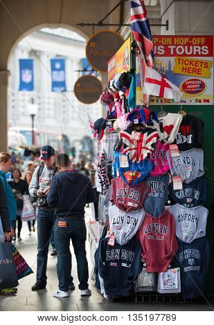 LONDON, UK - OCTOBER 4, 2015: Souvenir's stall in Piccadilly circus with lot of walking people, pedestrians