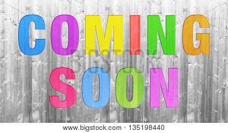 colorful COMING SOON word concept on wooden texture background