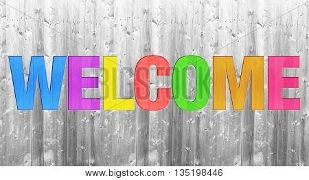 colorful WELCOME word concept on wooden texture background