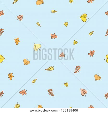 Seamless pattern with falling leaves on  blue background. Autumn season. Vector image.