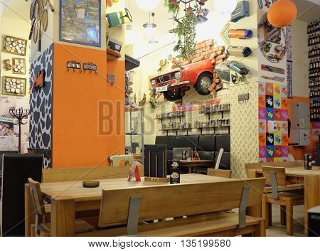 ORADEA, ROMANIA - AUGUST 01, 2015: Lactobar Retro Bistro it's furnished with colourful decor of period-piece found objects is remarkable, topped off with an orange, ultra-cool Dacia automobile