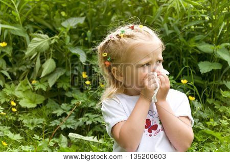 The girl is allergic to the pollen of flowers