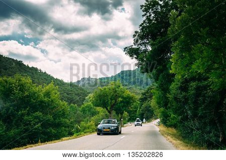 Verdon, France - June 29, 2015: Black colour Audi car on background of French mountain nature landscape