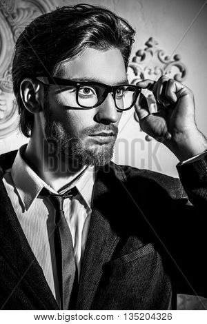 Handsome respectable middle-aged man in glasses. Men's beauty. Optics style.
