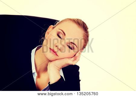 Tired business woman sleeping leaning on hand
