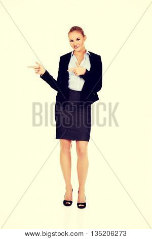 Businesswoman with finger pointing for copyspace or something