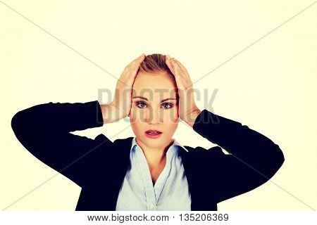 Business woman with a huge headache holding head