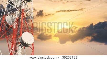 Telecommunications tower and satellite dish telecom network at sunset