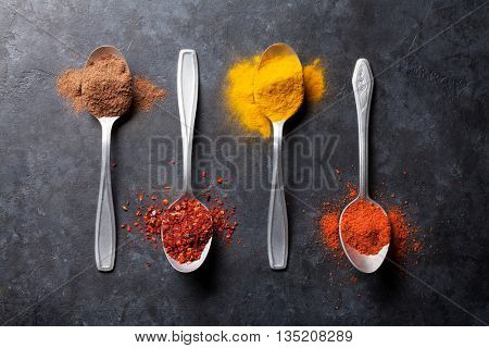 Colorful spices in spoons. Top view
