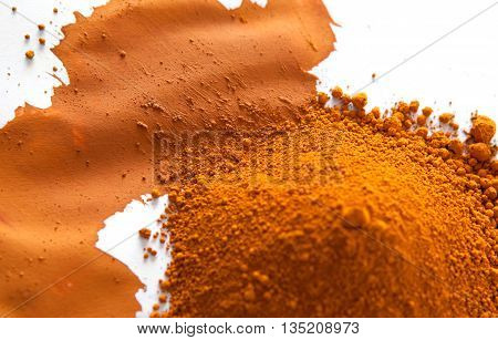Ochre also spelled ocher a natural yellow earth pigment based on hydrated iron oxide.