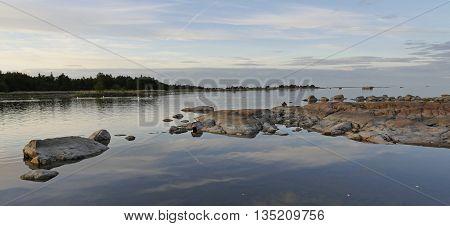Rocky east coast at sea archipelago in sunset