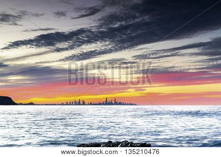 Colourful sunset over Surfers Paradise viewed form Currumbin Rock Gold Coast