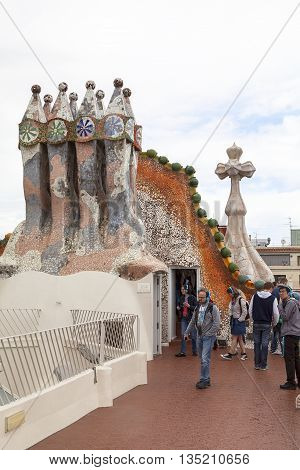 BARCELONA SPAIN - MAY 11 2016 : Tourists on the roof of Casa Batllo. Building redesigned in 1904 by Gaudi located in the center of Barcelona it is on the UNESCO World Heritage Site.
