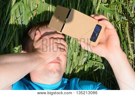 Young Man Looking Into A Virtual Reality Glasses