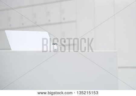 empty sign board for your text on counter table in clear white room interior