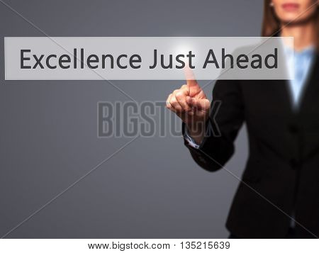Excellence Just Ahead - Businesswoman Hand Pressing Button On Touch Screen Interface.
