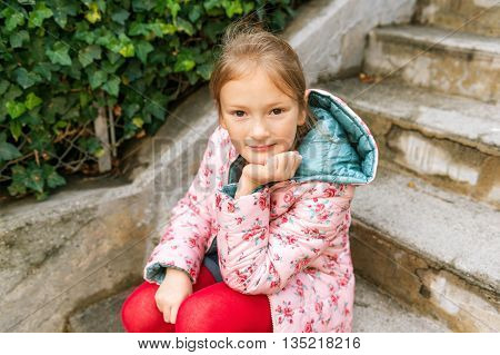 Outdoor portrait of a cute little girl of 8 years old