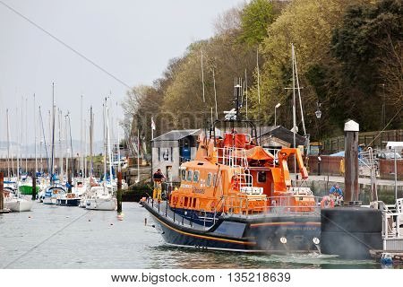 WEYMOUTH, UK - APRIL 17: The crew of the Weymouth lifeboat leave the harbour to attend a potential emergency at sea on April 17, 2015 in Weymouth. Weymouth RNLI responds to around 100 call outs p.a