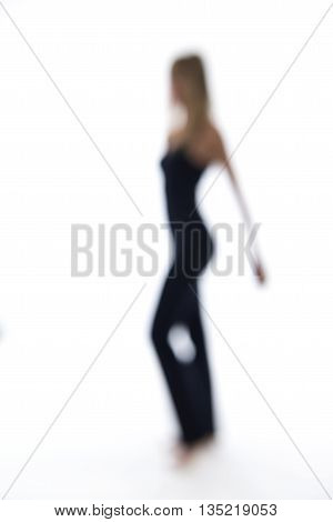 Blurry Woman Dancing On A White Backdrop