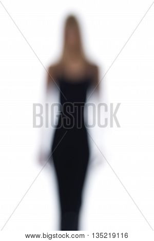 Blurred Silhouette Of A Woman On A White Backdrop