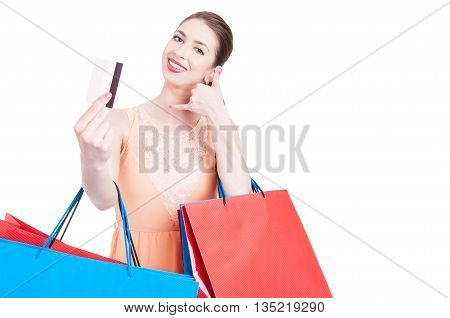 Lady Shopper Showing Credit Card And Making Call Me Gesture