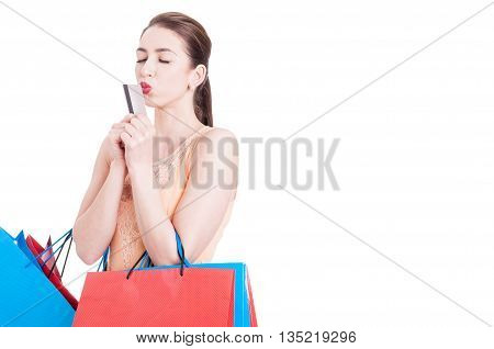 Lady Carrying Shopping Bags And Kissing A Credit Card