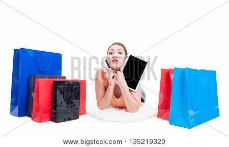 Lady Laying Around Shopping Bags And Holding Card And Tablet