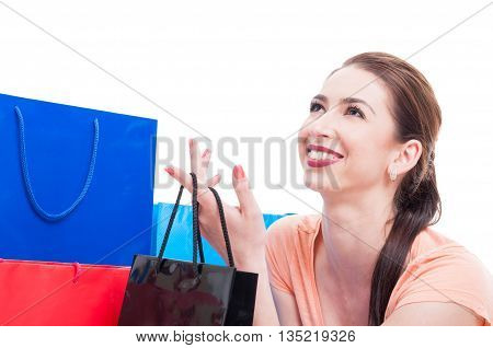 Young Beautiful Lady Smiling And Holding Shopping Or Gift Bag