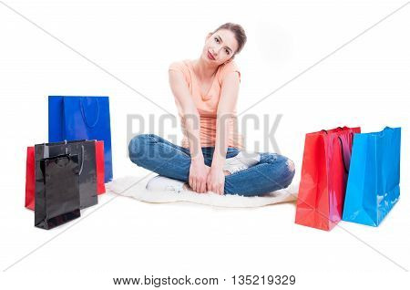 Woman Meditating In Lotus Position With Shopping Bags Around