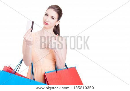 Woman Shopper Showing Credit Card And Making Thumb Up Gesture