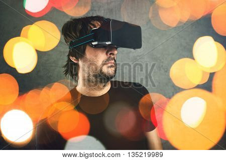 Adult man wearing virtual reality goggles and enjoying in 3D VR multimedia content