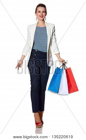 Happy Woman With Shopping Bags On White Background Going Forward
