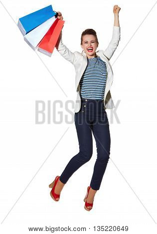 Happy Woman With Shopping Bags Jumping Against White Background